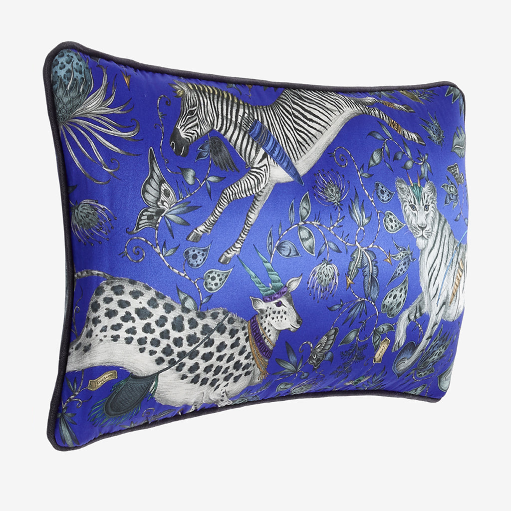 The side view of the Protea silk Double Bolster Cushion in Blue it's the perfect cushion to brighten up a lounge chair or to pile up on your bed to create a magic and comforting bed spread