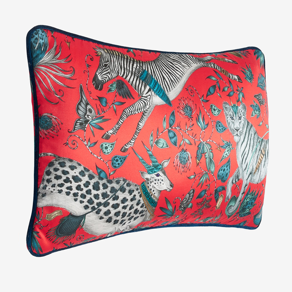 The side view of the Protea silk Double Bolster Cushion in Red it's the perfect cushion to brighten up a lounge chair or to pile up on your bed to create a magic and comforting bed spread