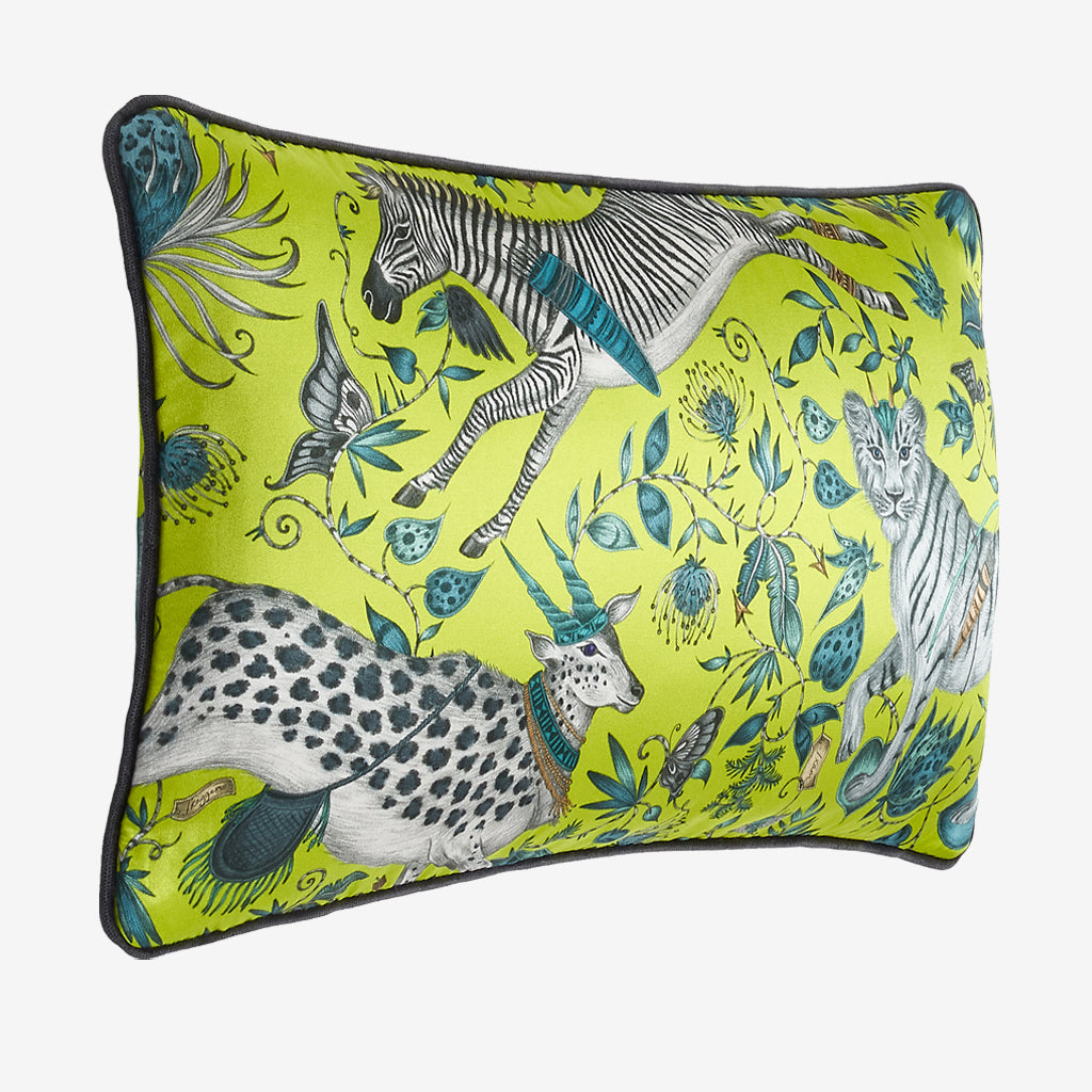A side view of the Lime Protea Silk Double Bolster Cushion showing the silk texture but also the charcoal grey edge. This Emma J Shipley Cushion is the perfect zebra and tiger inspired cushion to add a touch of animal magic to a chair, bed or windowseat