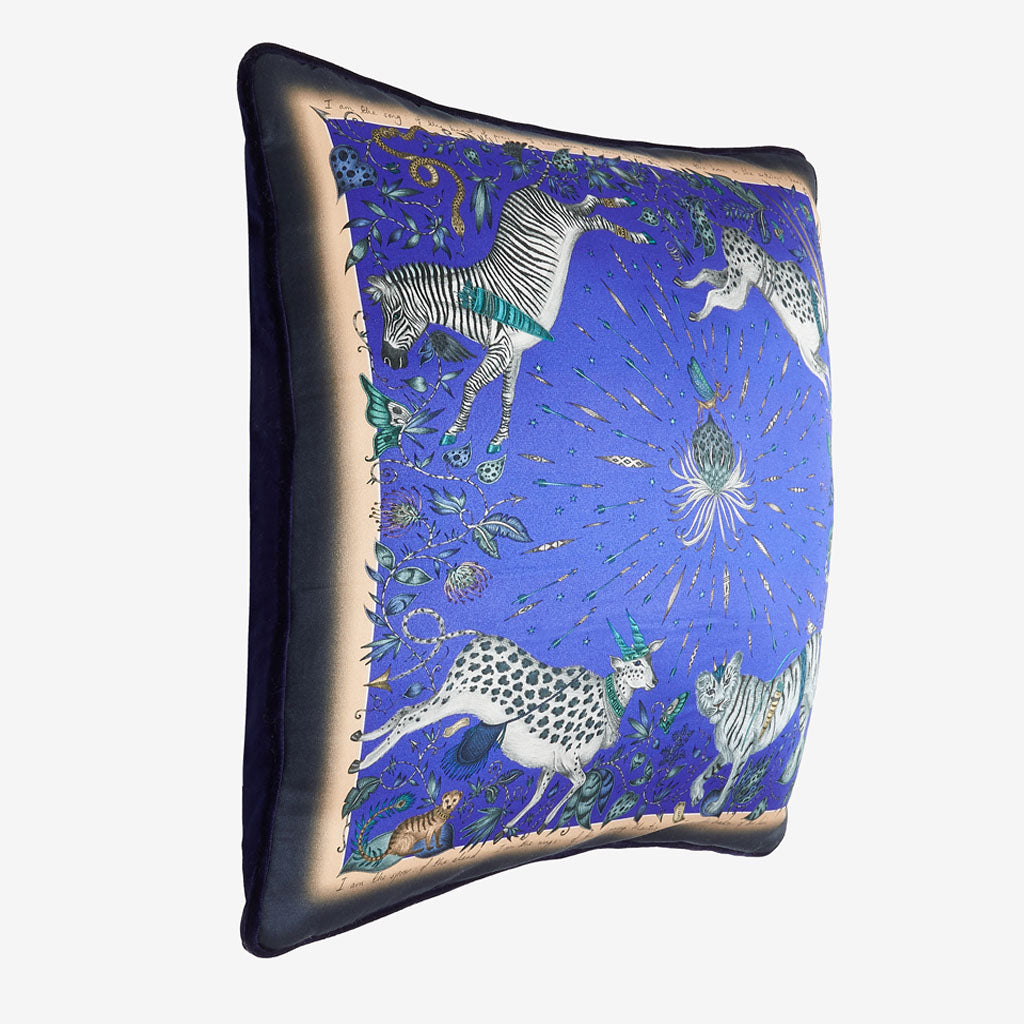 A side view of the deep blue protea silk cushion by Emma J Shipley. It's the perfect cushion to brighten up a sofa, chair, bedspread or window seat