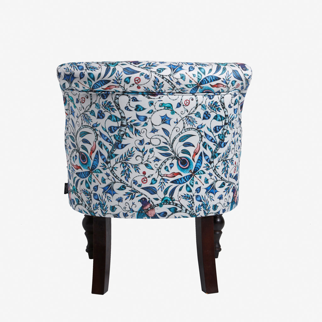 The charming Rousseau design from the Animalia collection appears on this exotic occasion chair designed by Emma J Shipley with Clarke & Clarke.