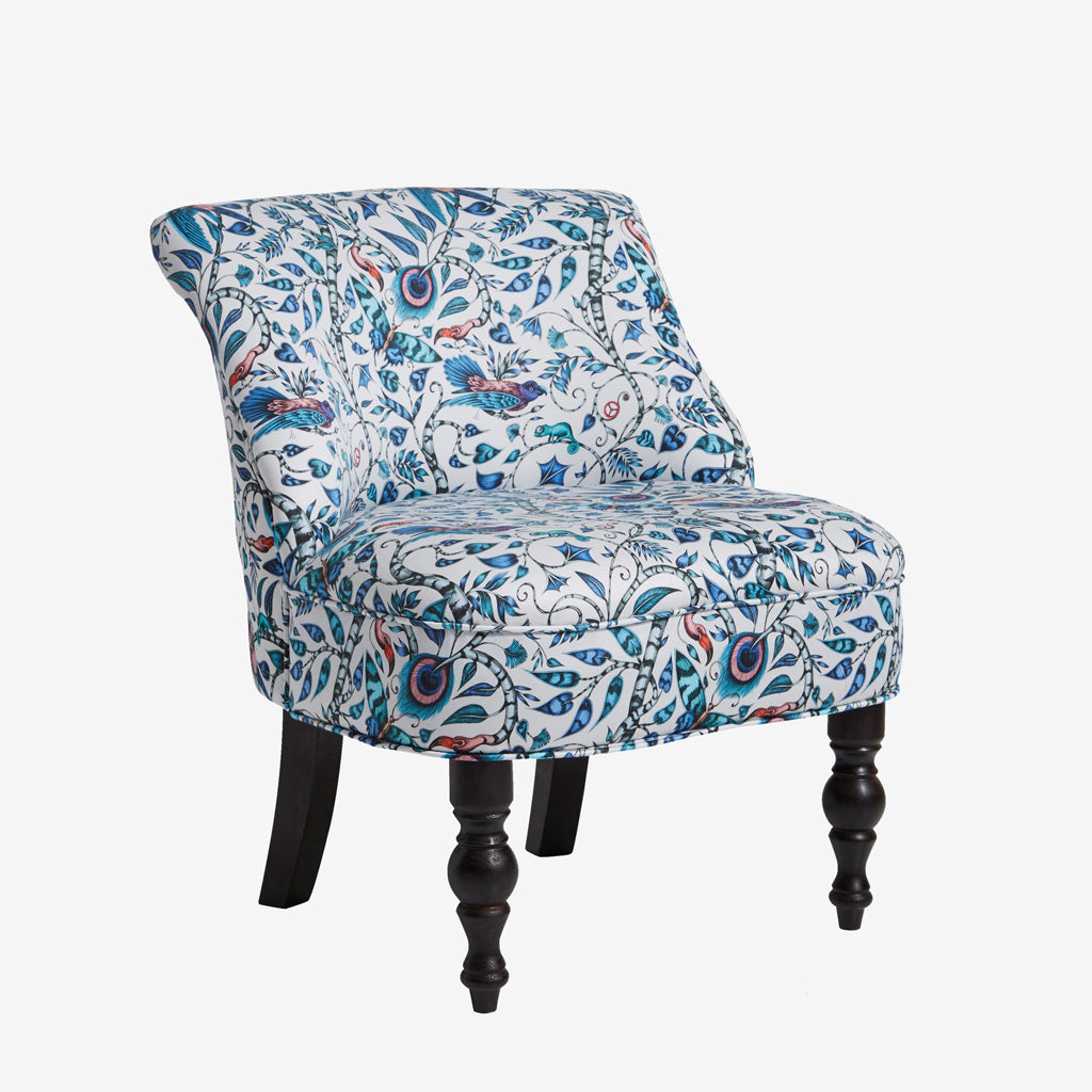 A bold piece of statement occasion furniture. The exotic Rousseau design hand drawn by Emma J Shipley features on this Langley Chair made in collaboration with Clarke & Clarke for Animalia