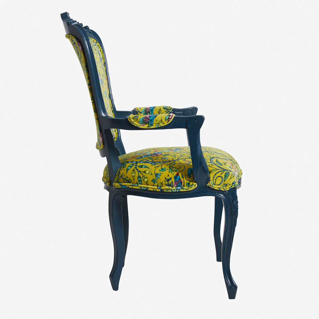 The Emma J Shipley for Clarke & Clarke Rousseau Antoinette Chair is a modern occasion chair upholstered with Animalia velvet fabric with jungle patterns and exotic colours