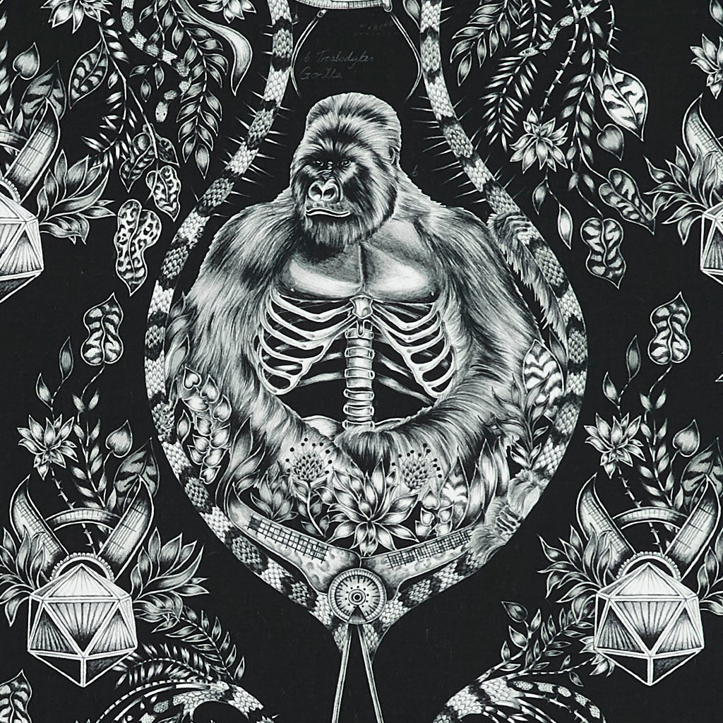 The Emma J Shipley Silverback Print design on Cotton Satin Made wit Clarke & Clarke. Featuring a gorilla and details of vines and the anatomy of the gorilla. This design really pops in this monochrome colour-way