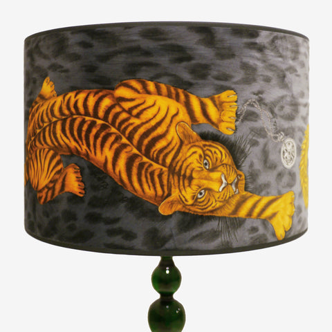 Velvet lampshade in the tigris pattern, featuring fiery tigers over a charcoal grey background