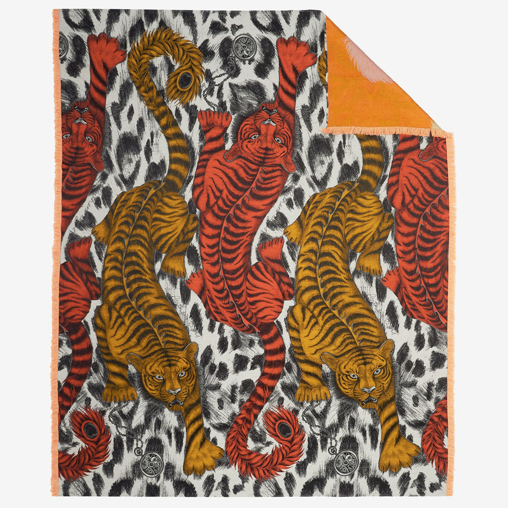 A wild tiger throw blanket in luxury silk and wool, from designer Emma J shipley, for nature lovers