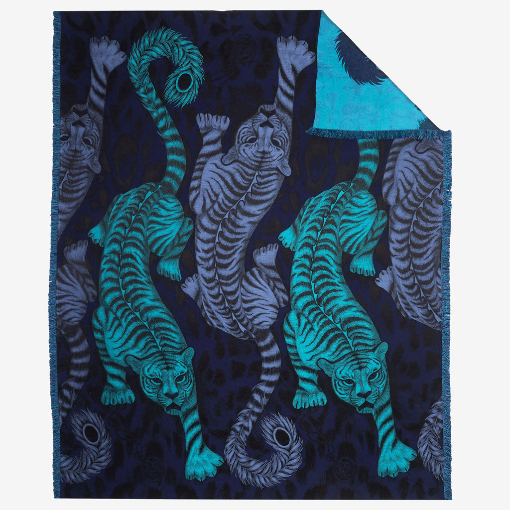 A luxury designer tiger blanket with rich blues and navy, woven in Italy in silk and merino wool for incredible softness and warmth