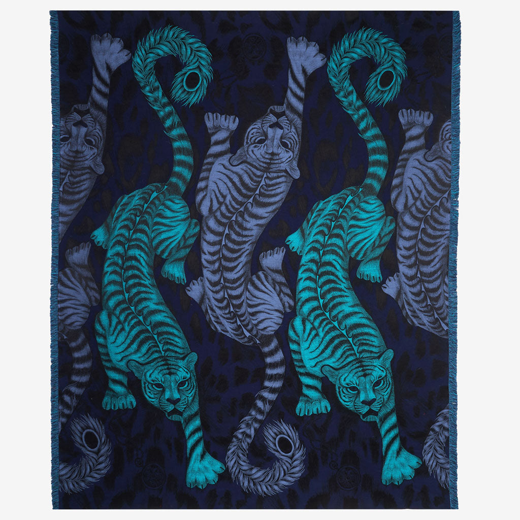 A striking navy luxury throw with bright blue tigers, woven in silk and wool