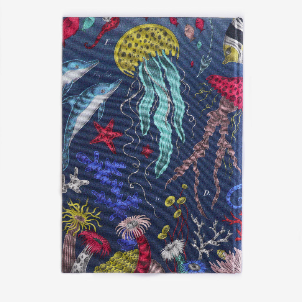 The notebook is inspired by scientific illustrations of sea creatures.