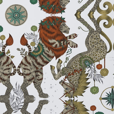 A close view of Caspian Wallpaper in Gold, showing a detailed look at the rusted orange maned Lions and the leopard spotted Unicorns. Designed by Emma J Shipley as part of the Wilderie collection with Clarke & Clarke, inspired by Narnia