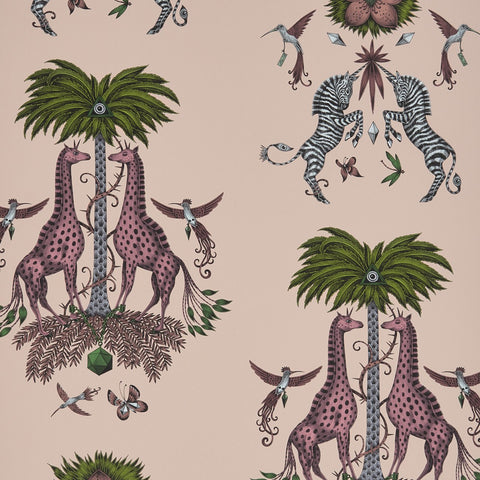 A close view of Creatura Wallpaper in Pink, showing a detailed look at the Giraffes, Palms and Zebras that are the perfect back drop for a soft animalia themed room. Designed by Emma J Shipley as part of the Wilderie collection with interior experts Clarke & Clarke.