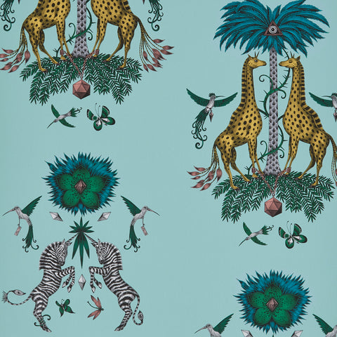 A close view of Creatura Wallpaper in Turquiose, showing a detailed look at the Giraffes, Palms and Zebras. Designed by Emma J Shipley as part of the Wilderie collection that will being luxurious animal magic to any home interior