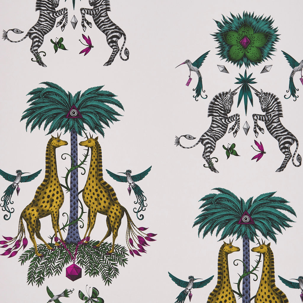 A close view of Creatura Wallpaper in Gold Yellow, showing a detailed look at the Giraffes, Palms and Zebra. Designed by Emma J Shipley as part of the Wilderie collection