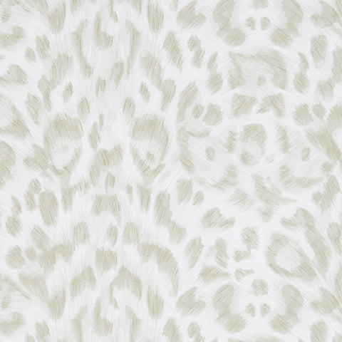 A close view of Felis Wallpaper in Nude, showing a detailed look at the texture and colours. Designed by Emma J Shipley as part of the Wilderie collection this wallpaper includes little metallic flecks that add a beautiful sheen to it.