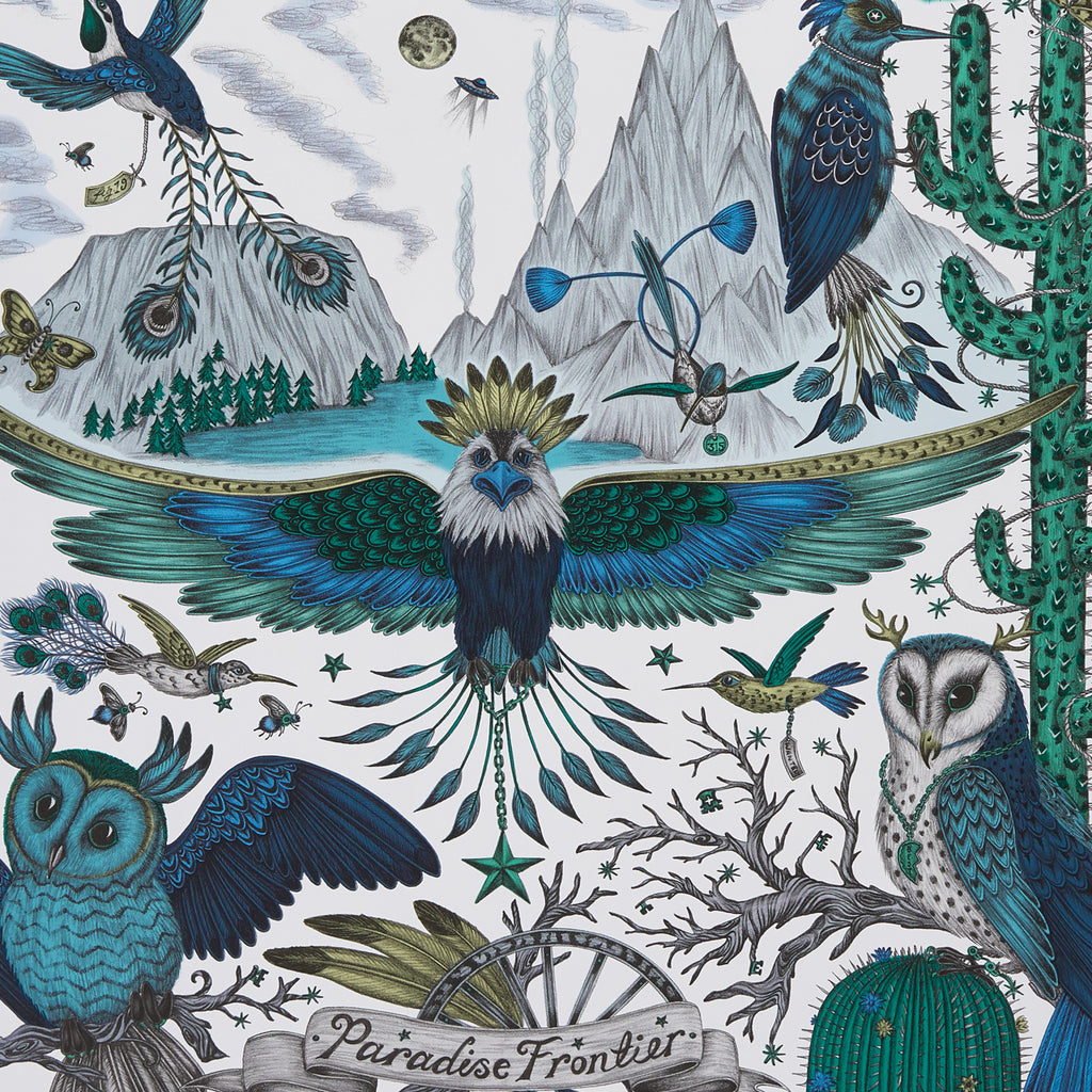 A close view of Frontier Wallpaper in Blue, showing a detailed look at the Owls, Eagle and Cactus. Designed by Emma J Shipley as part of the Wilderie collection made with Clarke & Clarke. The Blue tones create a really great scheme for any home interior