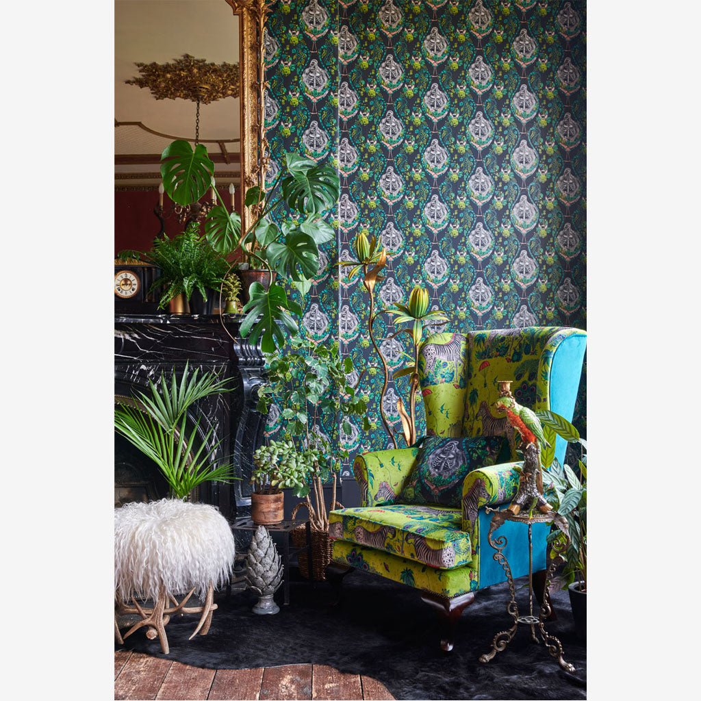 A Chair Upholstered in the new Wilderie fabric Lost World Velvet in Lime, the print was designed and drawn by Emma J Shipley