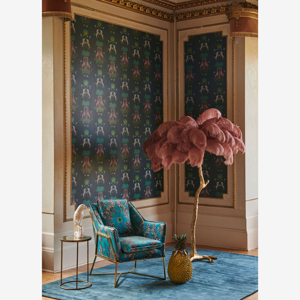 A wall covered in the new Creatura Wallpaper, colour Teal with accents of pink, lime green and green blues. Part of the Wilderie Range, by Emma J Shipley with Clarke & Clarke. Pair any of the fabrics with the wallpapers to create a vibrant theme
