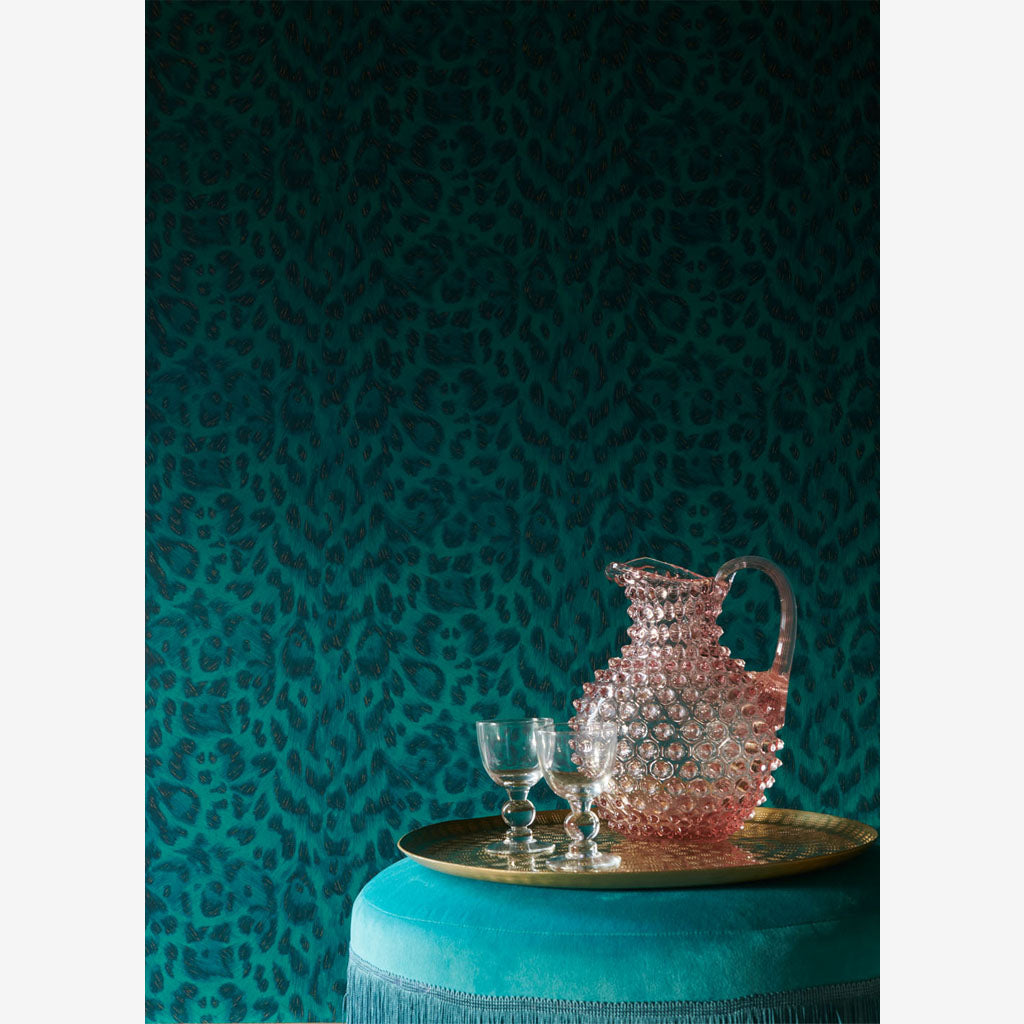 A Closer look at a wall covered in the new Felis Wallpaper, colour Teal Rose Gold. Part of the Wilderie Range, by Emma J Shipley with Clarke & Clarke