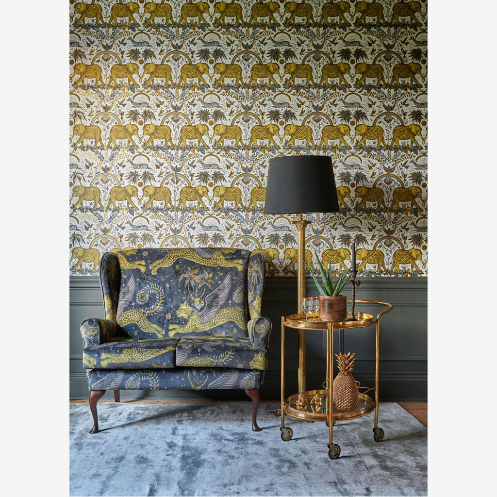A wall covered in the new Zambezi Wallpaper, colour Gold. Part of the Wilderie Range, by Emma J Shipley with Clarke & Clarke