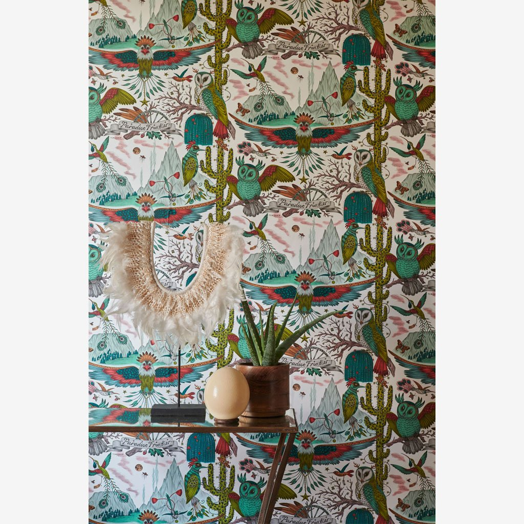 A Close look at the wall covered in the new Frontier Wallpaper, colour Lime. Part of the Wilderie Range, by Emma J Shipley with Clarke & Clarke. It's the perfect wallpaper to build texture and colour on and t really generate an interesting and maximalist scheme for any home interior
