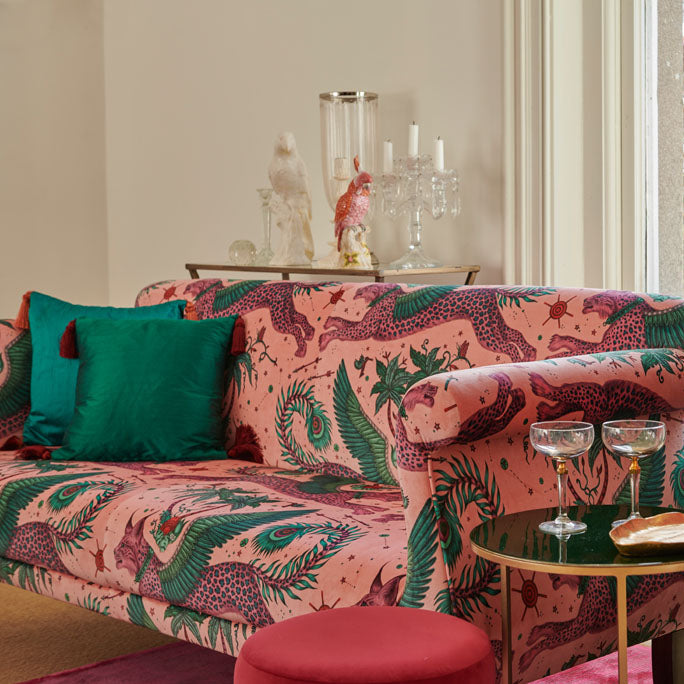 A lynx velvet used to upholster a sofa, also with cushions covered in the Money Sylph Silk Fabric, from the Wilderie Collection designed by Emma J Shipley. This is the perfect example of the Sylph fabrics being paired with the Wilderie products