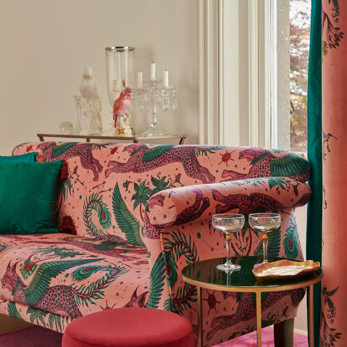 The fantastical Lynx Velvet in Pink used to upholster a sofa, part of the Wilderie collection designed by Emma J Shipley