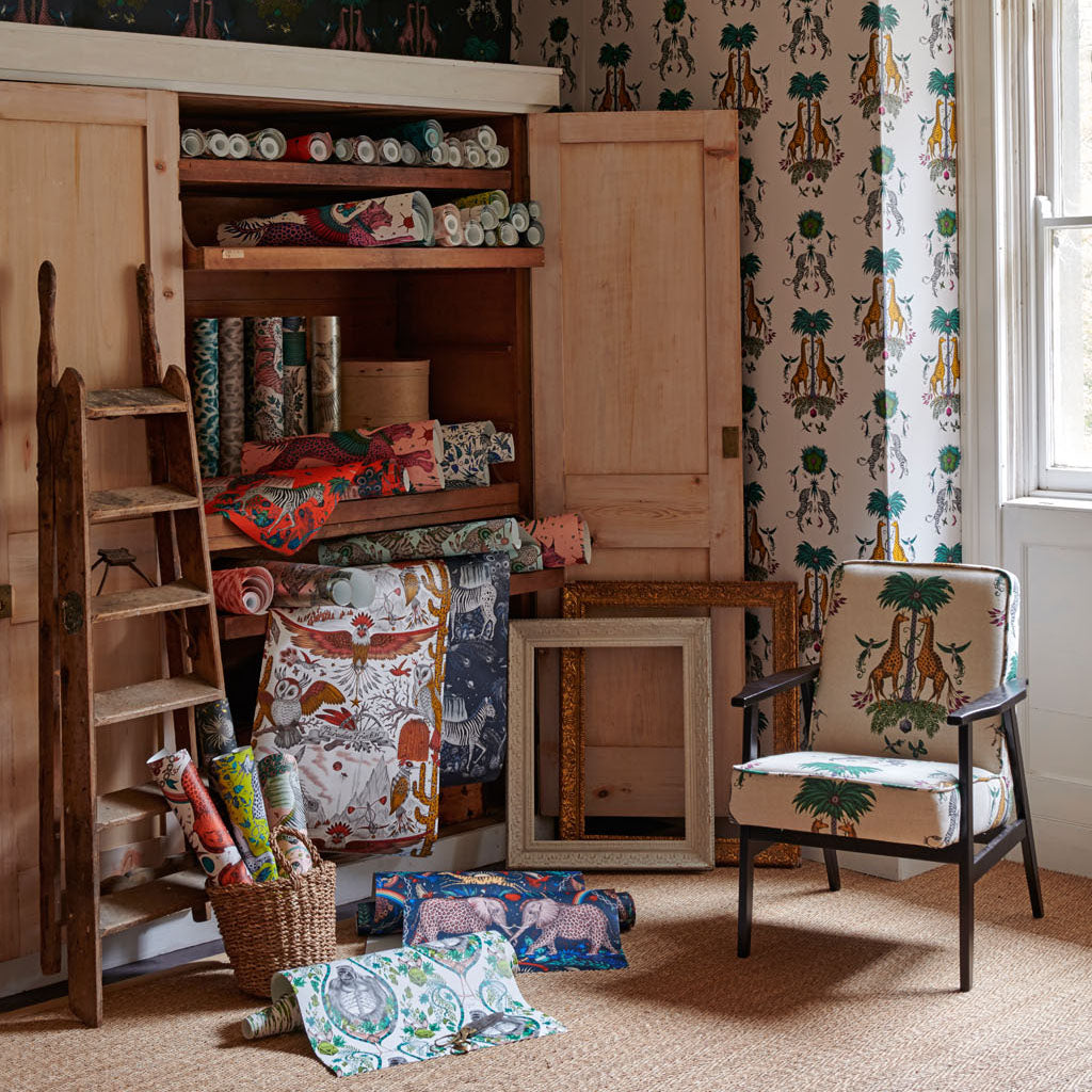A wall covered in the new Creatura Wallpaper, colour Gold Yellow paired beautifully with the same print in the linen fabric, showing how well the Wilderie collection can be put together. Part of the Wilderie Range, by Emma J Shipley with Clarke & Clarke
