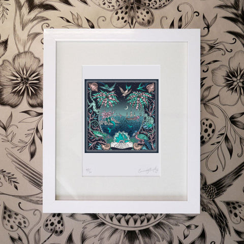 The sea themed Sirens print by Emma J Shipley is framed by animalistic palm trees, tropical bird life and mischievous monkeys amongst spotted shells and coral.