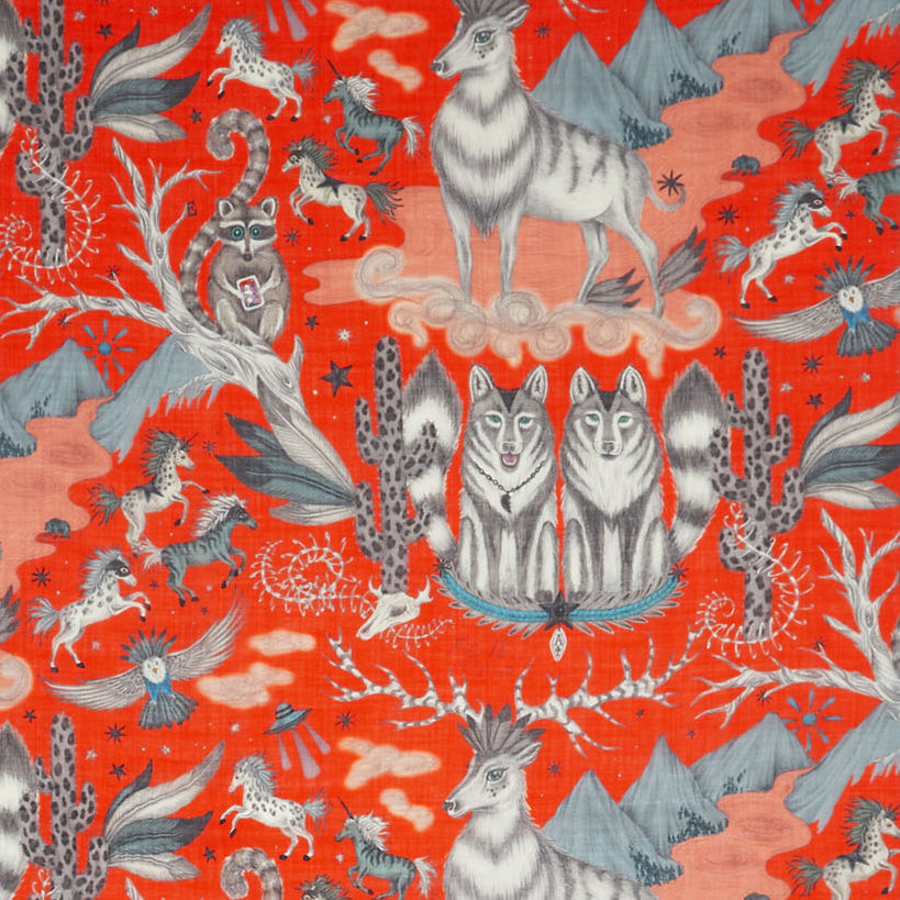 Imponent stags and observant wolves, on a close up of Emma J Shipley's Wild West design, upon a striking flame orange