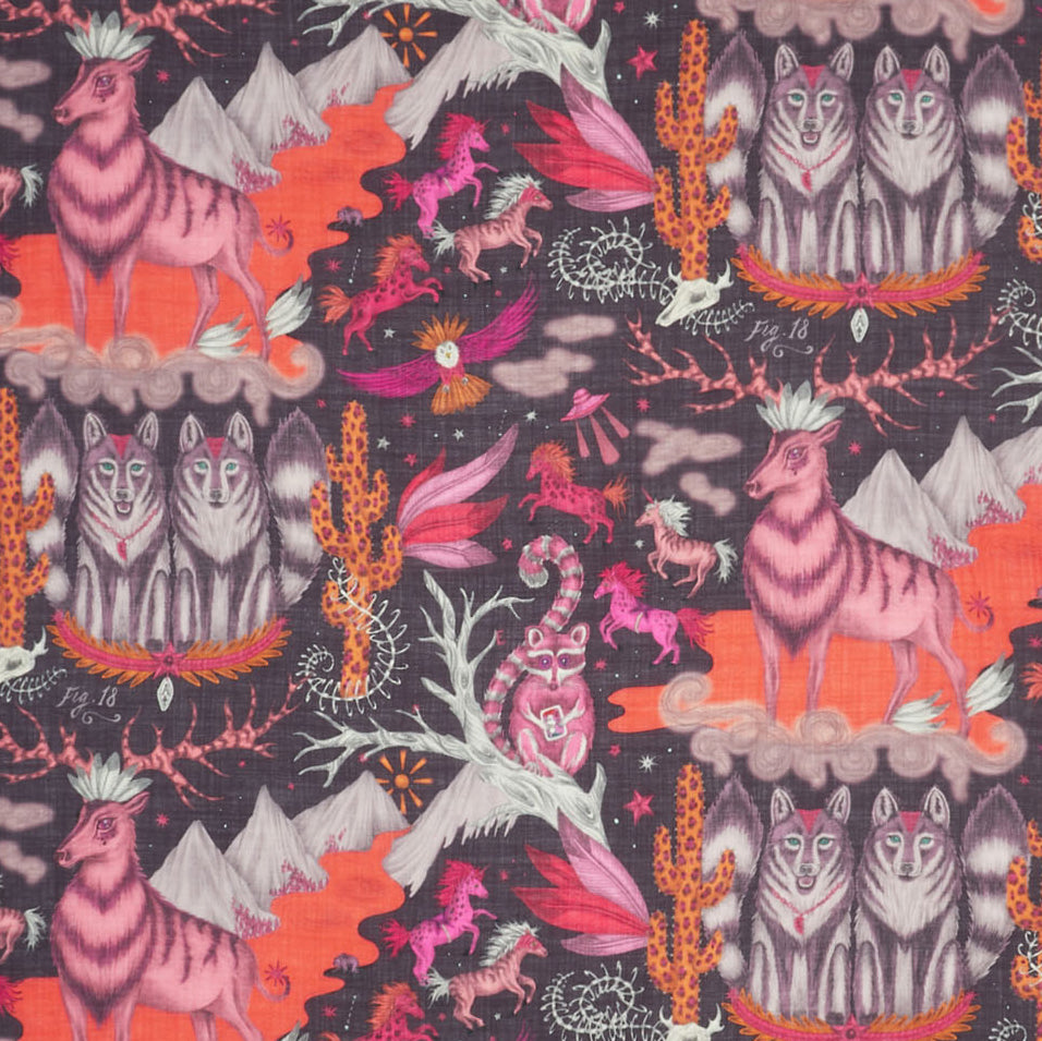 A close up of the Wild West fine wool shall, in rich violet. Part of Emma J Shipley's Wild Frontier collection, it features majestic stags and a pair of wolves