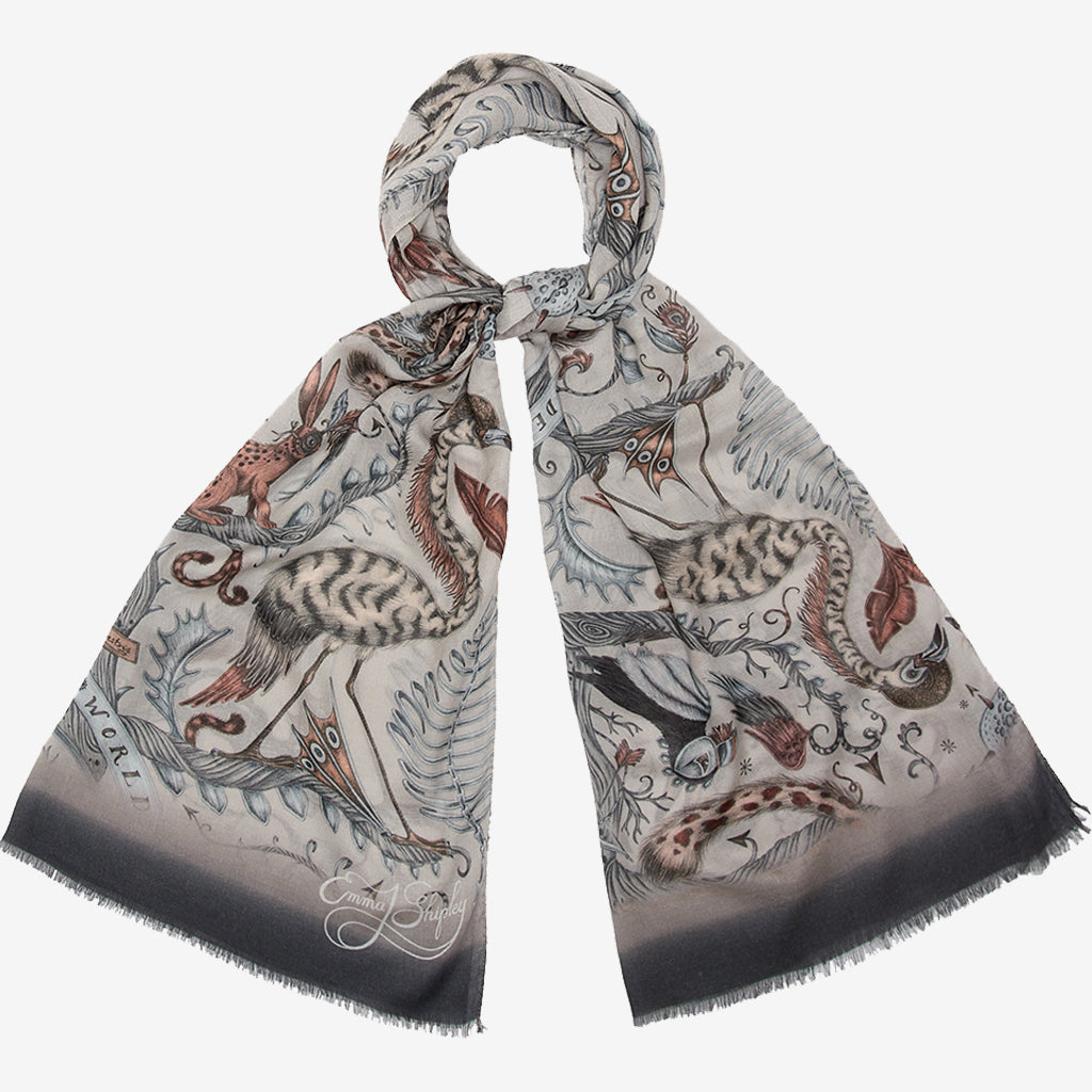 the New scarves from Emma J Shipley can be styled in many ways, here the Nude Leopard Wonder World Modal Cashmere Scarf is tied up to show how the pattern sits when together