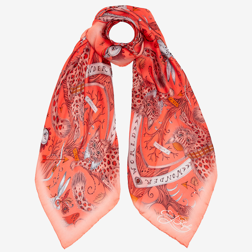 There are many ways to style the Orange Wonder World Silk Chiffon Scarf, even wrapped up the detail still shows the magical print and colours