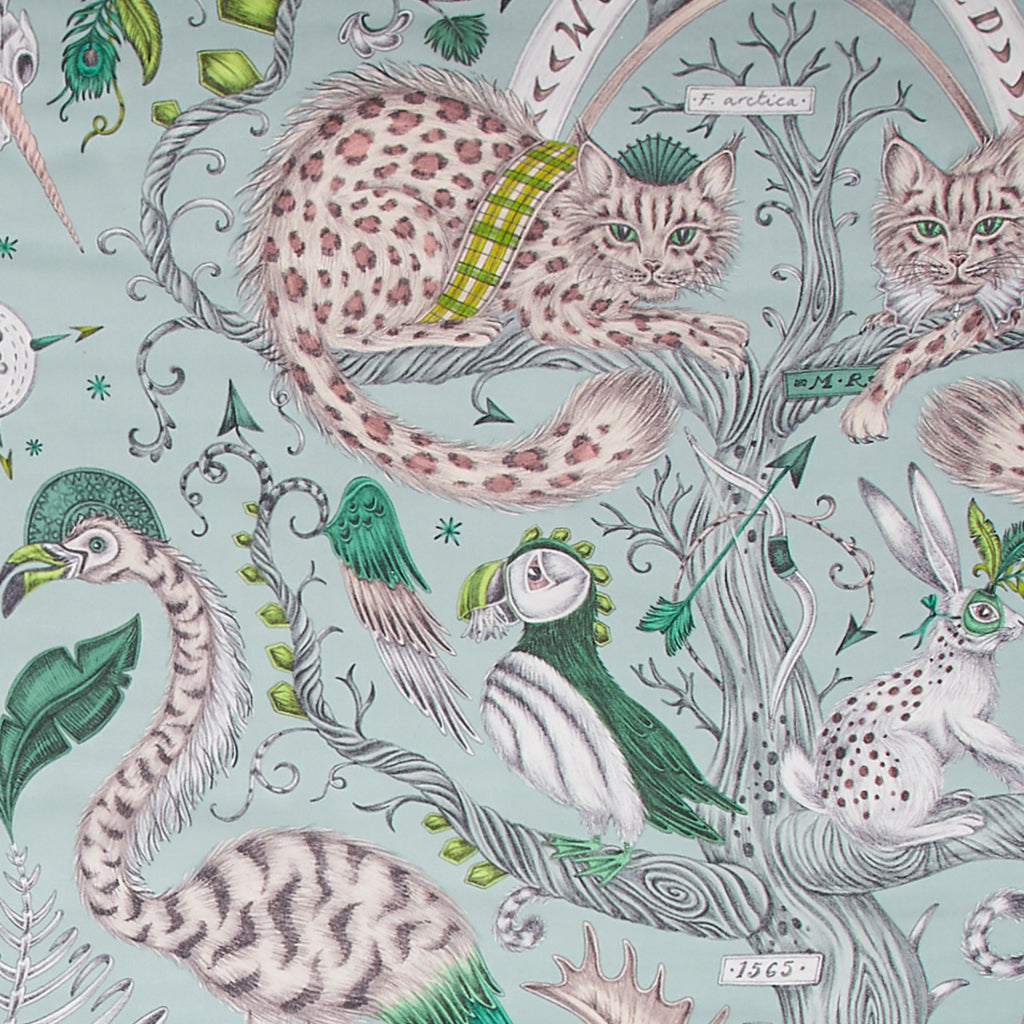 A close up of the green Silk Chiffon scarf with the Wonder World print on in leopard black. Showing the details of the cats and birds.