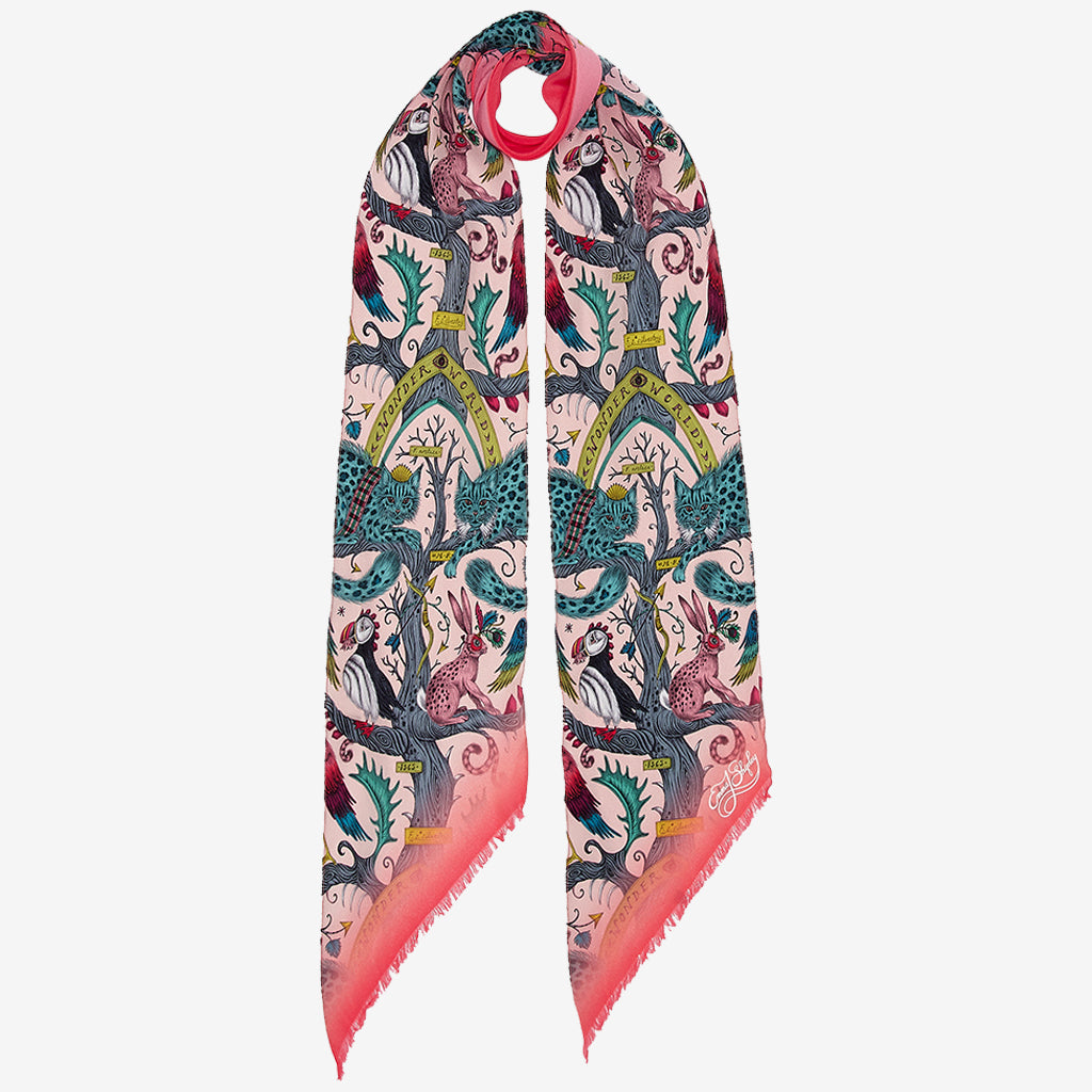 The new Wonder World Silk Skinny Scarf in Pink is the perfect small scarf to add a touch of colour and pattern to any outfit. The Wonder World Print is designed by Emma J Shipley and is inspired by her trip to Scotland and the mystical and magical creatures from the Highlands, evolutionary tree diagrams and medieval paintings