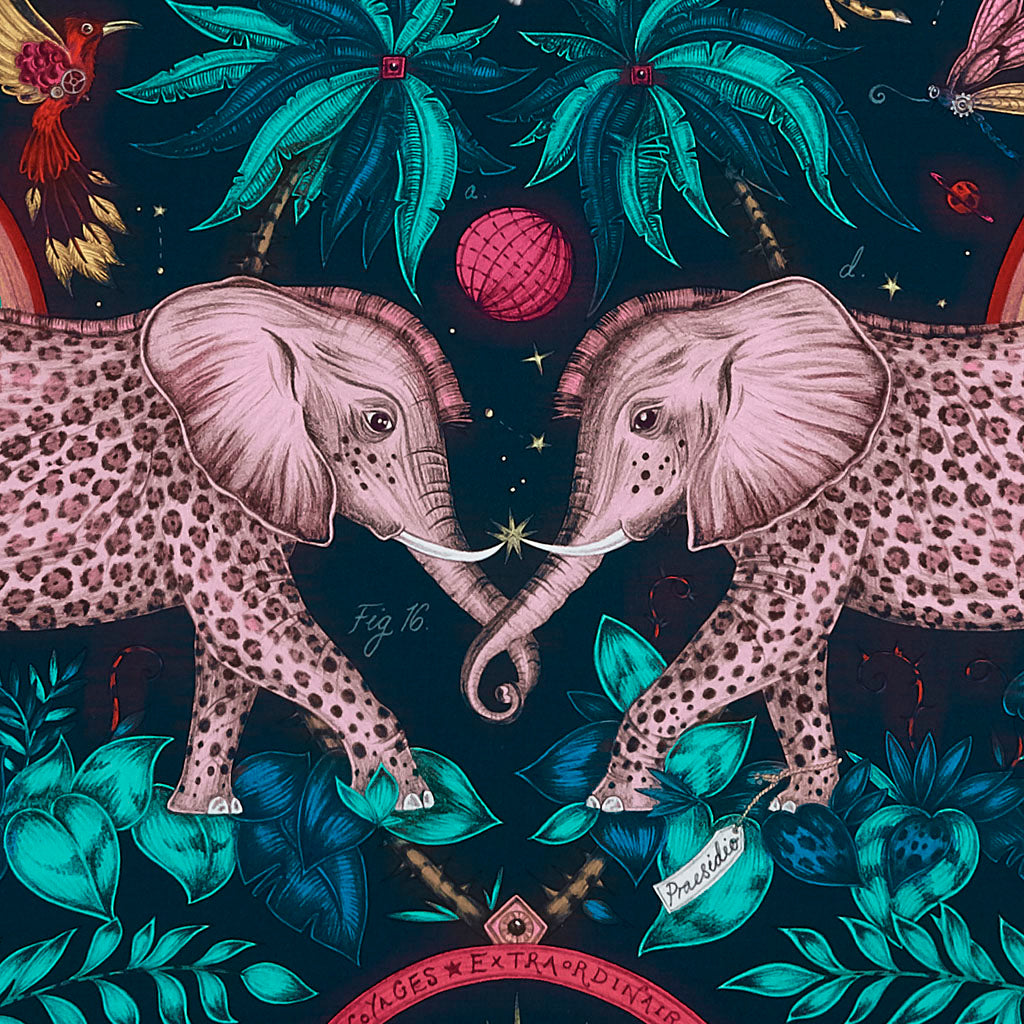A close up of the Zambezi Cotton Satin in Navy from the New Emma J Shipley Wilderie Collection with Clarke & Clarke. Featuring a jungle safari themed landscape with elephants, palms and gazelles, be inspired to create anything from this fabric including curtains, chair upholstery and any other home furnishings such as cushions or foot stools