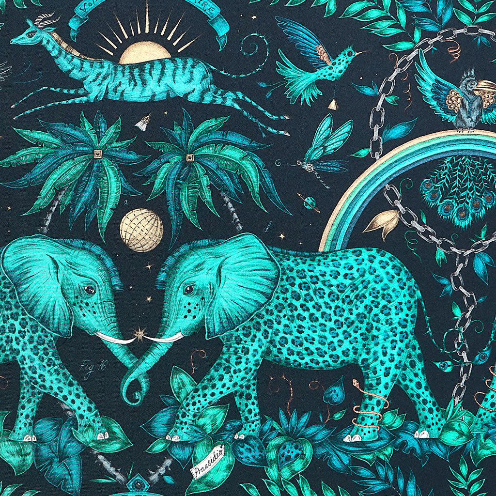 An up close look at the Fine Silk Artwork by Emma J Shipley in the Zambezi Design. The design features magical leopard spotted elephants, leaping gazelles and rainbows
