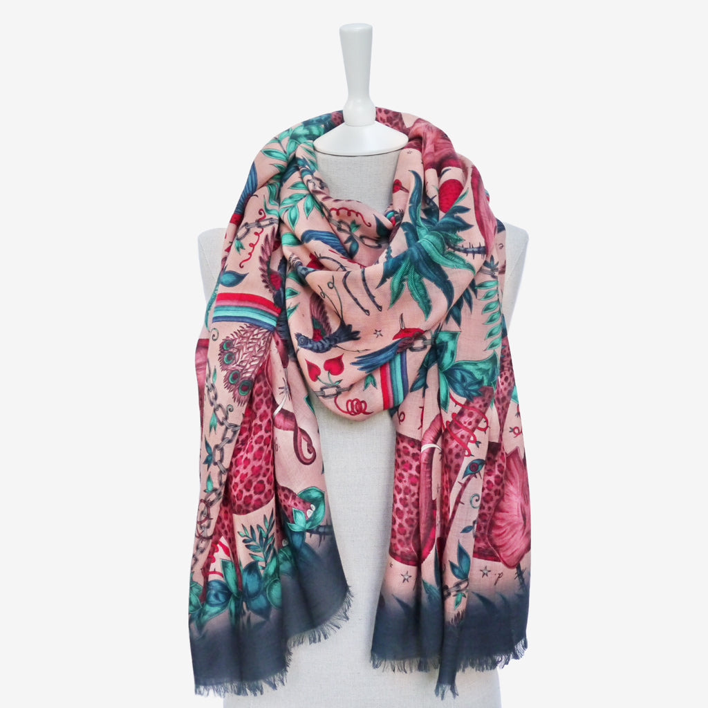 Emma J Shipley's hand drawn Zambezi design in pink, shown styled in a cosy, wrap around style perfect for the upcoming Autumn/Winter months