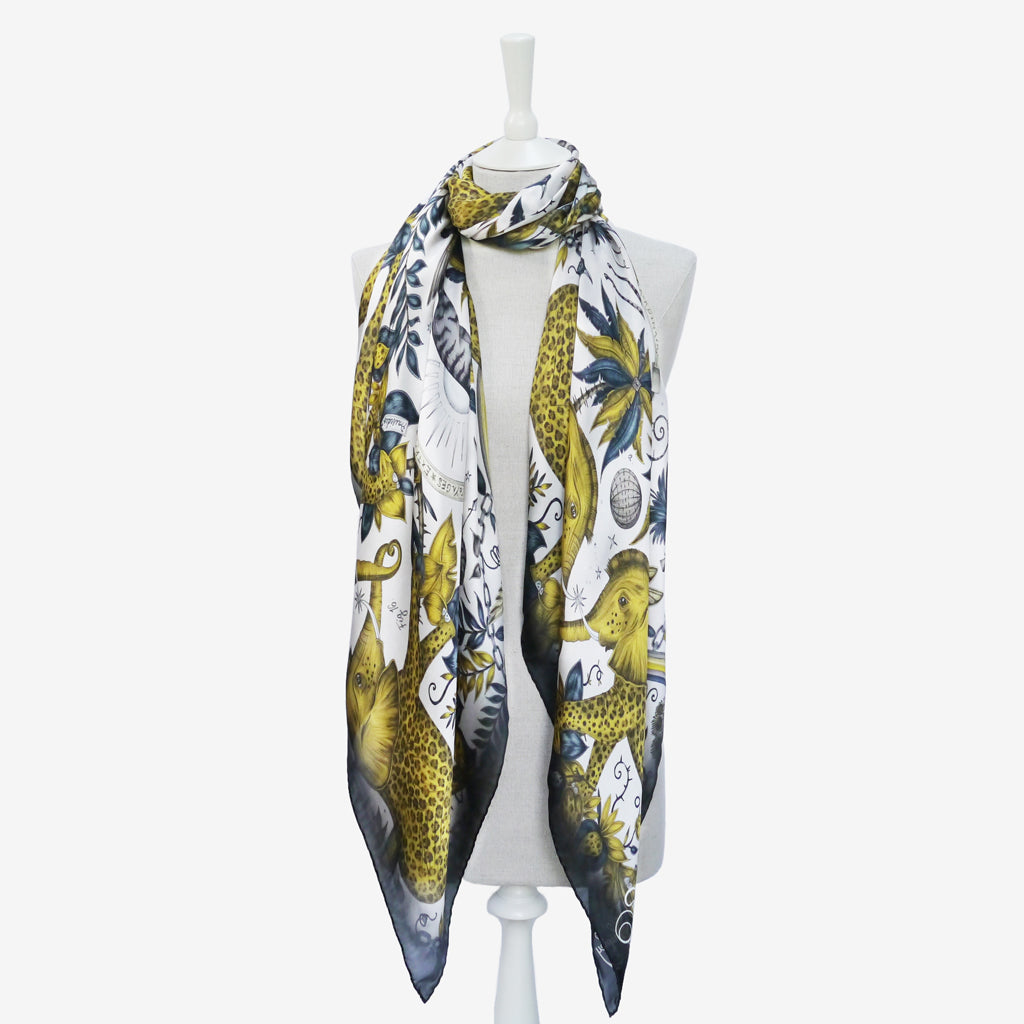 this example of how to wear the gold Zambezi Silk chiffon scarf demonstrates a style which drapes in a way to show off a variety of elements from Emma J Shipley's magical hand drawn design
