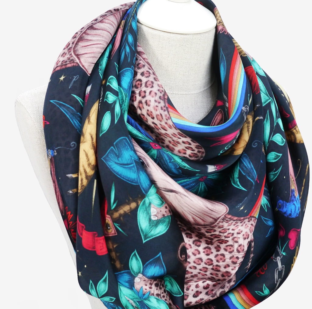 wearing the scarf in this voluminous wrap around style gives the full range of enchanting colours to be seen alongside subtler elements of Emma J Shipley's hand drawn Zambezi design
