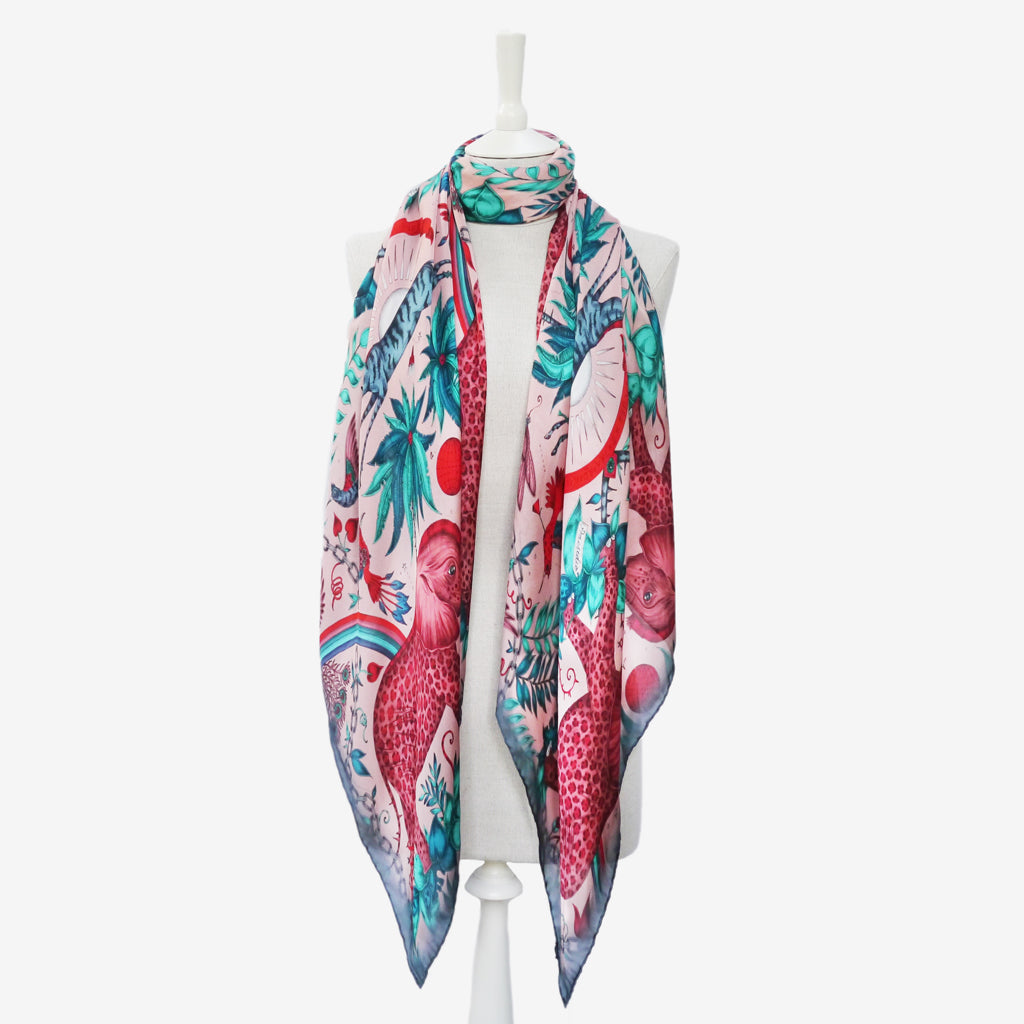 this example of how to wear the Zambezi silk chiffon scarf in pink demonstrates a simple but classic style which shows a range of elements of Emma J Shipley's design