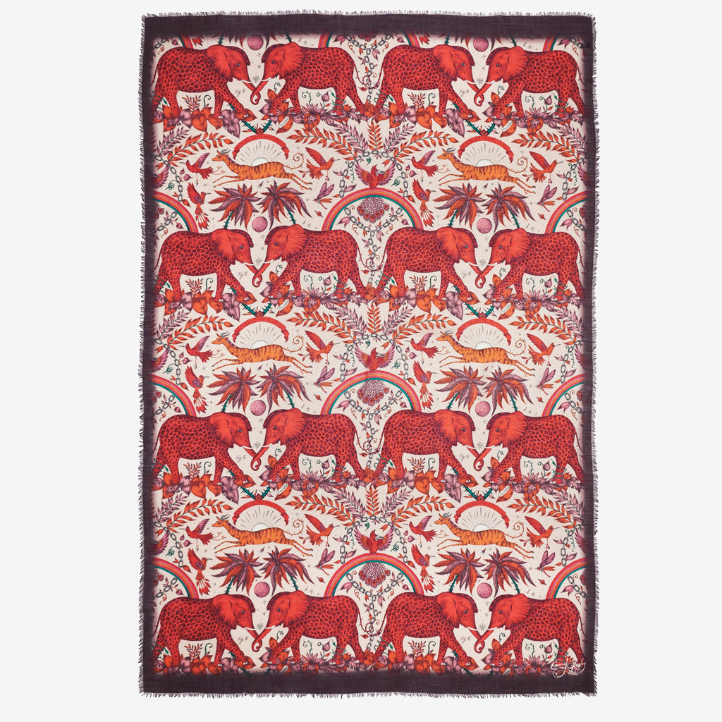 The fiery spotted elephants of the Zambezi Fine Wool Shawl are hand drawn by artist and designer Emma J Shipley