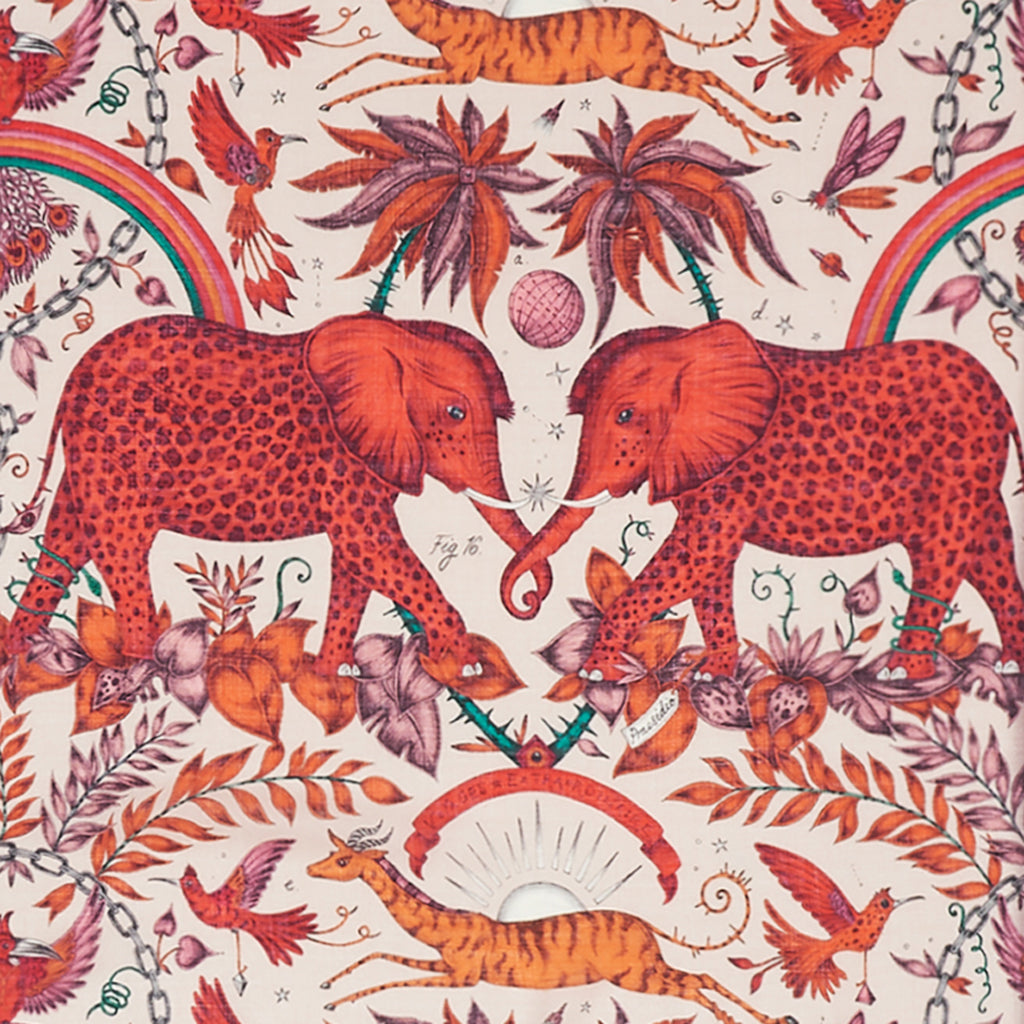 Close up of the luxurious fine wool shawl designed by Emma J Shipley, depicting a stunning array of safari creatures like elephants, gazelles and magical birds