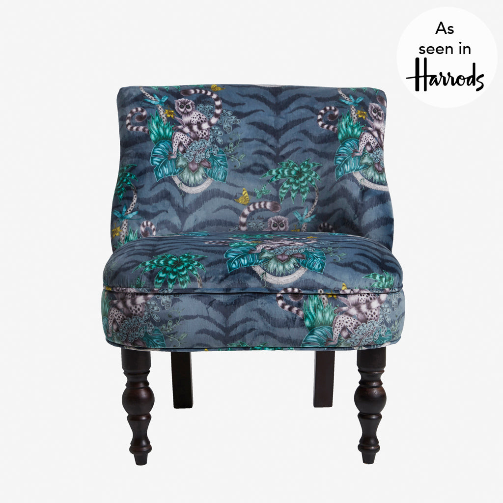This exotic occasion chair is designed by Emma J Shipley in collaboration with Clarke & Clarke. The Lemur Langley chair features the beautiful Lemur velvet navy fabric and an enchanting design of a curious lemur
