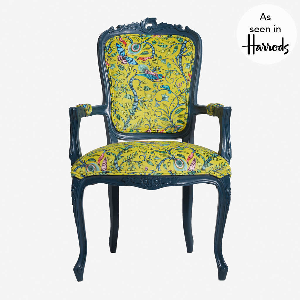 The Rousseau velvet Antoinette Chair designed by Emma J Shipley for Clarke & Clarke features a magical scene of jungle creatures on luxurious velvet to make a bold statement piece of furniture