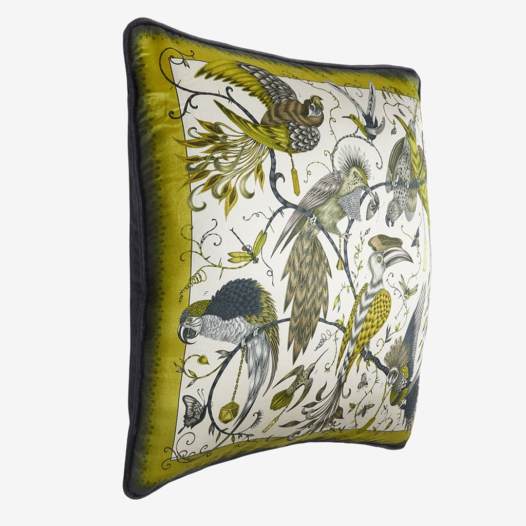 The Audubon cushion features a hand-drawn scene of fantastical birds illustrated by Emma J Shipley