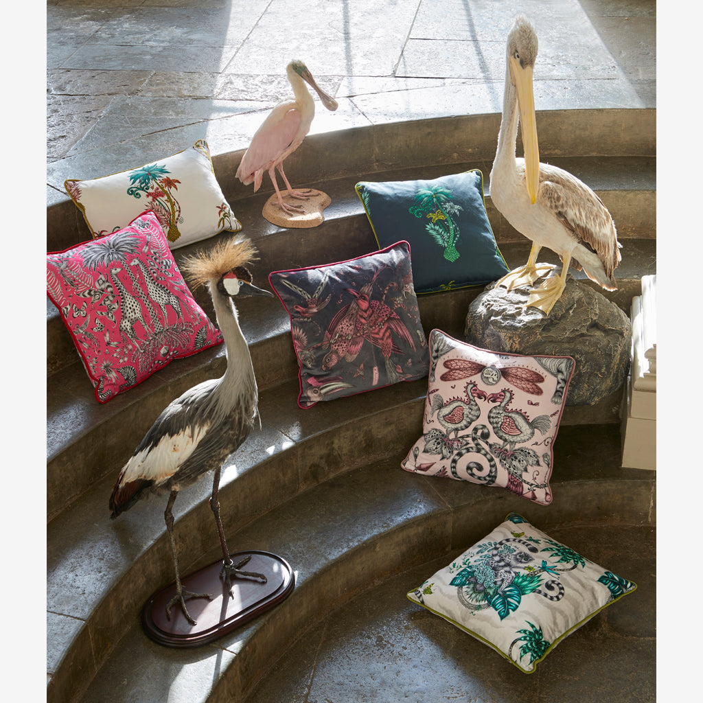 Campaign imagery showing Emma J Shipley x Clarke & Clarke Animalia fabrics made into cushions