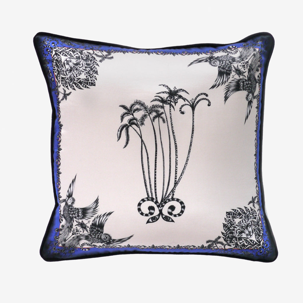The flat shot of the Emma J Shipley cotton and silk blend Amazon Palms Printed Cushion
