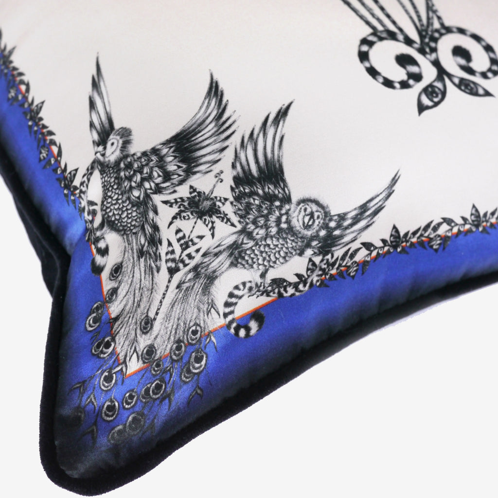A detailed close-up of the hand-drawn peacock-parrots that feature on Emma J Shipley's luxury Amazon Palms Printed Cushion