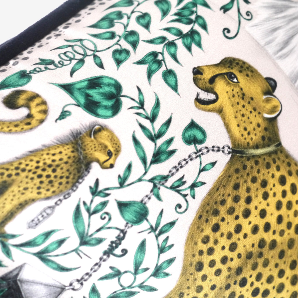 A detailed close-up of the two cheetahs that feature on the cotton and silk Cheetah Cushion by luxury designer and illustrator Emma J Shipley