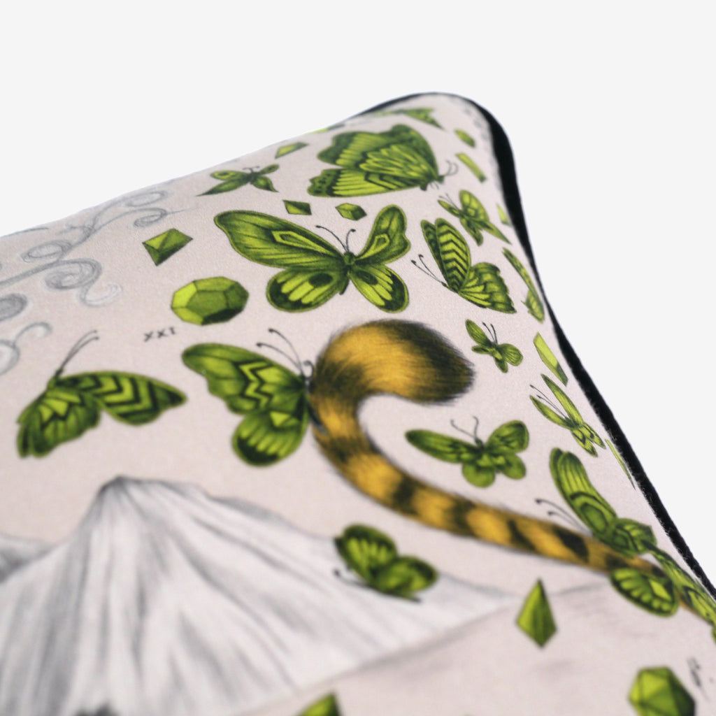 A detailed close-up of the hand-drawn butterflies that feature on Emma J Shipley's luxury Cheetah Cushion
